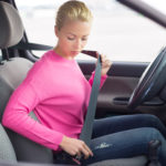 What are the pros and cons of wearing my seatbelt?